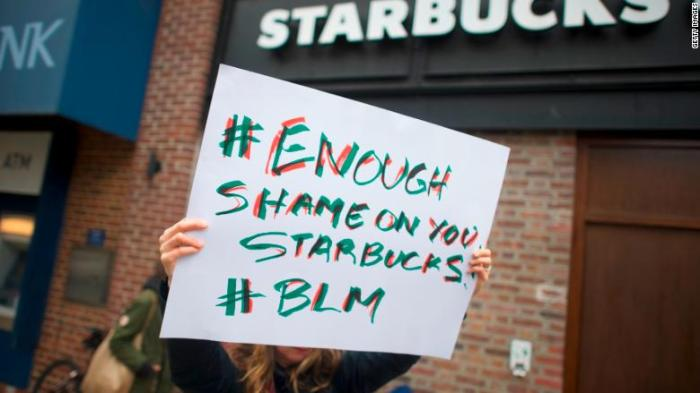 180416102242-protests-sign-starbucks-780x439